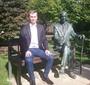 Piotr Zygadło on the Karski Bench, sitting next to his hero  (Photo: Courtesy of Piotr Zygadło)