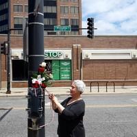 Loyola University Professor, Bożena Nowicka McLees at the Jan Karski Way street sign in Chicago, IL (Photo: Marek Adamczyk)