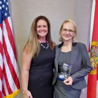 President of the Florida Council for the Social Studies, Peggy Renihan and JKEF's Project Manager, Bożena U. Zaremba (Photo: Lauren Samoszenko)