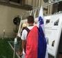 People carefully view the bilingual (English/Polish) exhibit. (Photo: Dariusz Paczkowski)