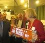 Wanda Urbanska accepting the Jan Karski Way sign from Mark Orwat of the office of Alderman John Arena, 45th Ward representative (Photo: Bożena U. Zaremba)