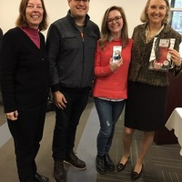 Jane Robbins with Anne Teicher and Wanda Urbanska holding the graphic novel that Anne won by answering a question correctly (with Anne's husband, Zach) (Photo: Jane Robbins)