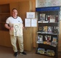 Robert Kobylarczyk, an English teacher at the Elementary School No. 1 in Tuszyn, Poland, showcasing books, educational materials about Karski, and contest artwork (Photo: Robert Kobylarczyk)