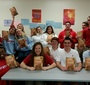 Charlotte Catholic HS students show off the donated copies of Karski's Story of a Secret State (Photo: Donna M. Tarney)