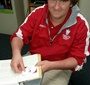 Charlotte Catholic HS student attaches a JKEF bookplate onto the donated copy of Karski's Story of a Secret State (Photo: Donna M. Tarney)
