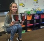 A student of the Polish Supplementary School in Rockaway Beach, NY, reads the graphic novel about Karski (Photo: Agnieszka Misior)