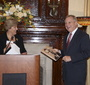 Senator Durbin seems delighted to receive a copy of the Karski Photobiography (Stacey Brazen)