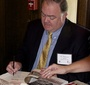 Tom Wood signs copies of his biography of Karski (Stacey Brazen)