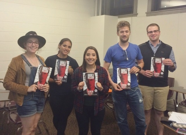 Loyola University Chicago students holding the graphic novel about Jan Karski (Photo: John Merchant)