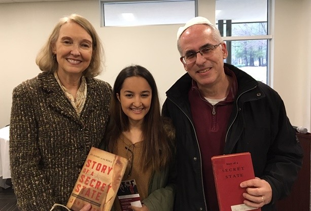 Wanda Urbanska, showing off the 2013 Georgetown University edition of Karski's Story of a Secret State; Nepali medical student, Jasmine Sinkhada; and Dr. Stuart J. Levin, holding Karski's 1944 edition of Story of a Secret State (Photo: Jane Robbins)